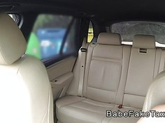 Young guy bangs busty female taxi driver