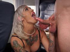Tattooed flight attendant Kleio Valentien sucks dick on plane