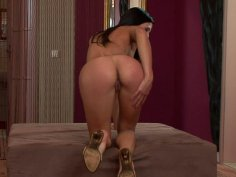 Brunette demoness Britney fingers her pussy and diddles her clit